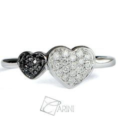 """ L'amore è composto da un'unica anima abitata da due corpi"" (Aristotele) Due cuori che si uniscono, due essenze bianca e nera che si fondono in un'unica creazione. Diamanti Neri ct 0.05 Diamanti Bianchi ct 0.13  #carinigioielli #springsummer2017 #italianjewelry #etsylent #handmade #rings #gemstone #sparkle #jewelrydesign #inlove #wedding #luxury #fashion #quotesoftheday #style #cute #instagood #love #gettingmarried #isaidyes #accessories #jewellery #trendy #musthave #diamonds #proposal"