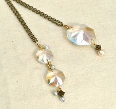 Salvaged chandelier crystals with pearls on brass necklace chains.