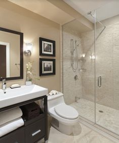 A gorgeous bathroom draped in natural hues and warm lighting. Click to see 8 small bathroom designs that we think are worth copying. #Smallbathroomdesigns