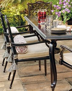 Dine in the elegant company of our Glen Isle Midnight Gold Dining Collection. Inspired by neoclassical interiors, the aluminum frames are expertly double-cast in molds that are handcarved by master artisans.  | Frontgate: Live Beautifully Outdoors