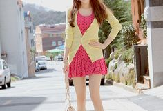 Very cute outfit for spring with the pink dress and the yellow cardigan.