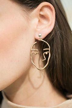 Face earrings.