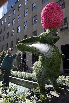 Gardener Steve Gilroy waters a 9-foot bunny topiary made of moss and ivy, balancing an egg made of Gerber daisies on its nose in the Channel Gardens of New York's Rockefeller Center. Associated Press