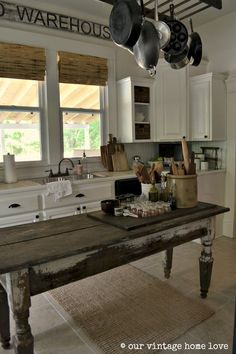 The whole house tour is so beautiful. This island looks so great against the crisp white cabinets from our vintage home love: Our Home