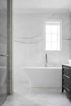 A stunning bathroom made of Cremo Delicato marble. (Credit: Adrien Williams) #sponsored