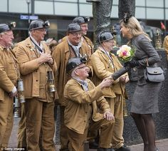 Queen Maxima greets retired miners near the Miner's Monument d'r Joep