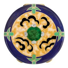 Art Deco Gold, Platinum, Enamel and Diamond Rouge Pot  14 kt., the circular rouge pot applied with decorative blue, yellow and green enamel, centering four bean-shaped platinum plaques set with 8 rose-cut diamonds, opening to reveal a mirror, circa 1930