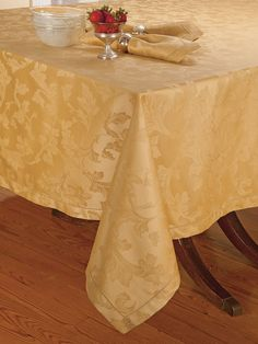 Kingsbury - Fine Table Linens - Shining as softly as candlelight, this sumptuous Gold damask tablecloth will cast an enchanting golden glow over your favorite dining experiences