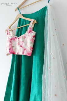 Beautiful Raw Silk Green Lengha Skirt with White and Pink Floral Blouse. Shop now at poppylane.ca