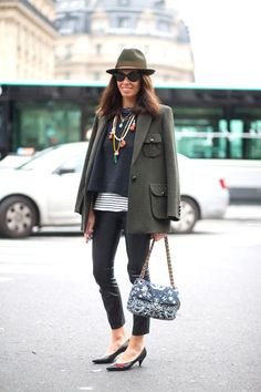 Leather leggings, a jacket draped over the shoulders, and a sleek felt fedora—all the things we love in one ultra-chic outfit.