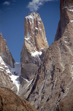 The Trango Tower (6239 m), commonly called Nameless Tower, is a very large pointed spire which juts 1000m out of the ridgeline.  The Trango Monk (5850m) is to the left of Trango Nameless Tower. Located at Baltoro Glacier in Pakistan