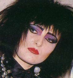 Siouxsie Sioux with violet eyes.