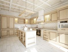 Kitchen with very light wood cabinets, white island, and wood-beamed ceiling. .