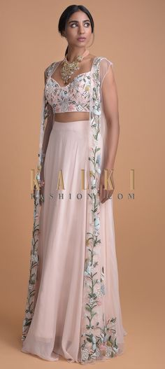 Powder pink flared skirt in chiffon. Paired with a matching embellished crop top with thread, cut dana and beads work in floral pattern. Kurti Designs Party Wear, Lehenga Designs, Indian Wedding Outfits, Indian Outfits, Indian Designer Outfits, Designer Dresses, Stylish Dresses, Fashion Dresses, Long Skirt Outfits