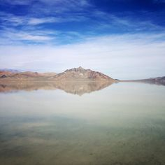 Currently traipsing around the salt flats and Silver Island Mountains in northwestwest Utah! The wind picked up about 30 seconds after capturing this with my phone and it hasn't let up disturbing the water surface since. As they say the best camera is the one you have with you!
