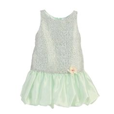 As a must have of the warm season, there are always pretty dresses by Angels Garment to consider. This mint green sleeveless poly dupioni dress features a mesh overlay on bodice and a cute bubble skirt. It has an irremovable flower accent in front and a s