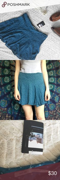 "NWT UO Kimchi Blue Patterned Blue Motif Skirt Urban Outfitters • New with tags • Size 2 • Measurements: Waist: 14"" straight across. Length: 13.5"" • In absolutely perfect condition • 100% rayon • Tight at the waist and has a zig zag seam that creates a flowy fit • Patterned with tiny clovers / flowers • Has a concealed zipper and hook on the left hip • Originally $59 Urban Outfitters Skirts"