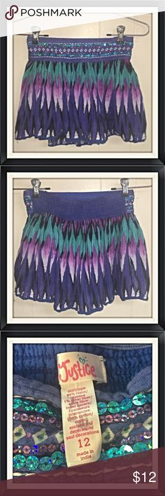 Girls Size 12 Skirt Justice size 12 girls skirt. Good used condition - No stains or tears - Built in shorts underneath! Justice Bottoms Skirts