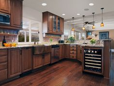 Kitchen remodel ideas. I like the long bar, lighting, and openness between the kitchen and dinning area.