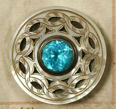 ca 1790 French carved mother of pearl button set in metal backing, with a beautiful turquoise crystal cabochan with metal collet. From a very rare 1790 button sample book.