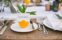 Fruit - Wedge a paper name card into a piece of artfully sliced citrus! {Our Labor of Love Photography}