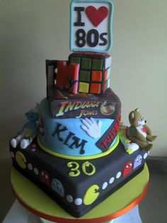 80's themed cake for 30th birthday... Wonder if I could pull this off, or something similar for Bruce....