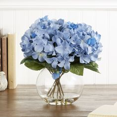 Faux Blue Hydrangea Bloom | Always in bloom, this small blue hydrangea flower in a round bubble glass vase adds elegance and beauty to any tabletop.