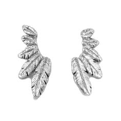 This ear crawler set was made by Navajo artist Neeko April and features hand-carved feathers in sterling silver or bronze. This ear cuff is part of...