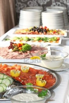 Smoked salmon platter on a buffet table with an assortment of additional platters of cold meat at a wedding function Stock Photo
