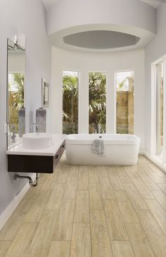 #Luxury #Bath featuring #Magnolia #Fir - Available from #MidAmericaTile | #WoodLook  #porcelain #plank #tile #FirWood #modern #design #bathtub #retreat #MasterBath #InnovativeLooks