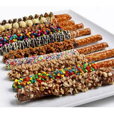 Next time there's a snack attack, they'll be ready. This classy combo of salty and sweet features pretzels dipped in rich chocolate and drizzled with nuts and candy. 12 pieces.