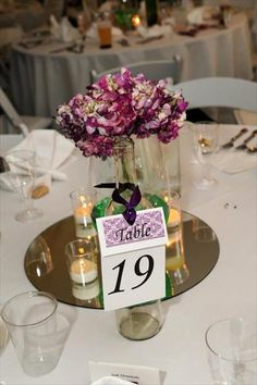centerpieces...wine bottle, flowers, table number in one!
