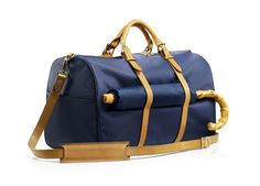 The Monaco Weekender Bag in Navy and Tan from Stuart & Lau. Lightweight, weatherproof, and equally useful as a gym bag or an overnight carryall - the monaco is a thoughtfully designed update on the classic men's weekender bag. sized to meet carry-on requirements, it includes features for the frequent traveler, such as: lock-compatible zipper tabs, exterior pockets for your passport and other items needed readily at hand, and our signature luggage tan pen & stylus attachment. Crafted from...