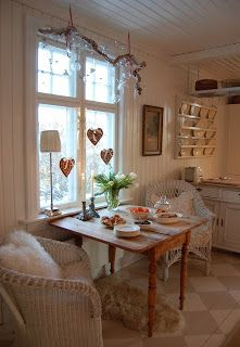 I really like the table and I love it sidled up against the wall under a window.