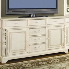 """Stow DVDs, books, and electronic accessories in this weathered wood media console, offering 6 drawers and 2 doors for maximum storage.    Product: Media consoleConstruction Material: WoodColor: Distressed linenFeatures: Part of the Paula Deen Home Collection Six drawers and two doorsDimensions: 36"""" H x 66"""" W x 22"""" D   Note: Price is for the cabinet console that the TV is resting on. Side bookcases and bridge are not included."""