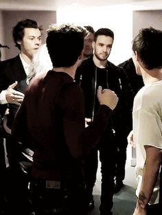 One Direction was back together at the X-Factor to support Louis