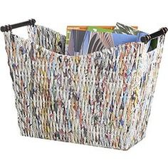 Recycle. Renew. Repurpose. This basket is the perfect example of what to do with old news. Made with recycled newspapers, this eco-friendly basket is woven over a metal frame with wood handles. This Pier 1 exclusive is great for holding all your latest magazines (not included) or to hold files and important papers