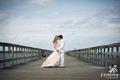 Rehoboth Beach Wedding Photography; Bride and Groom portraits on pier; Beachy wavey bridal hair; Groom in Sear Sucker Wedding Suit