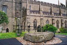 The grave of the Three Irish Saints... St. Patrick, St. Brigid and St. Columcille. Down Cathedral, Downpatrick, Northern Ireland.