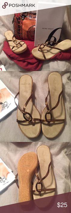 NWT Nine West sandals color bronze cork wedge NWT Nine West bronze color size 9 1/2, made in Italy. Synthetic upper/rubber sole Nine West Shoes Wedges