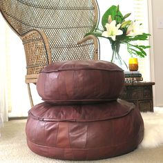Leather Pouffe Duo – Classic Brown These beautifully soft leather pouffes would look sensational in any bedroom, living room or outdoor area. They are made in Istanbul Turkey, are 100% genuine lamb skin leather and are available in a huge range of colours. The single tone leather floor cushions feature a star design stitched into the top and single colour panelling on the side and underside. They can be used as a foot stool, side table or seating.