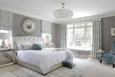 This stunning master bedroom in muted tones is an example of how well grey can work when combined with the right light shades and pattern to lift it.   Minhnuyet Hardy Interiors, LLC