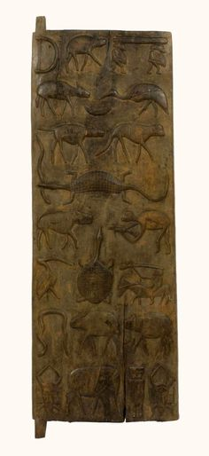 Africa | Door from the Senufo people of Korhogo, Ivory Coast | Wood.  This types of doors were reserved for nobles and the wealthy.  The rest had wickerwork doors | Prior to 1963