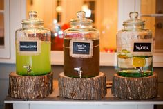 Rounds of a tree make perfect risers for drinks at a backyard vow renewal