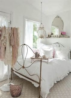 shabby chic decor - I have this bed!  I guess I know now that I need to paint it white or cream.