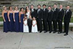 The wedding party poses for a shot at Sunset Zoo on October Photo courtesy of Captured Moments Photography. Zoo Photos, October 5th, Unique Settings, Outdoor Venues, Bridesmaid Dresses, Wedding Dresses, Big Day, Perfect Wedding, Real Weddings