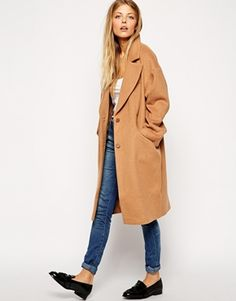 Must be this strong British preppy look this cocoon coat is oozing that makes me want to reach to my loafers, my check scarf and my long umbrella. Oh yeah! http://asos.to/1qhbKff