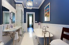 Navy and white classic fun in this kids bathroom in a New York townhouse.
