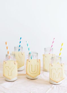 here's an idea for your next party: bottles of milk with cookie banners!