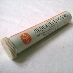 Dequadin Lozenge, we were given them for sore throats as kids. They had a distinctive, but nice taste and made your tongue go slightly numb.